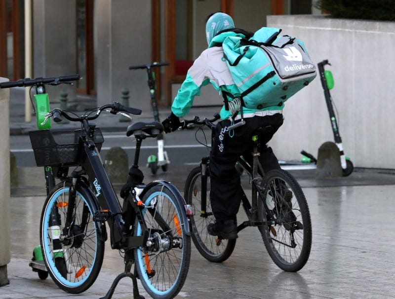 FILE PHOTO: A courier for food delivery service Deliveroo rides a bike in central Brussels, Belgium January 16, 2020. REUTERS/ Yves Herman