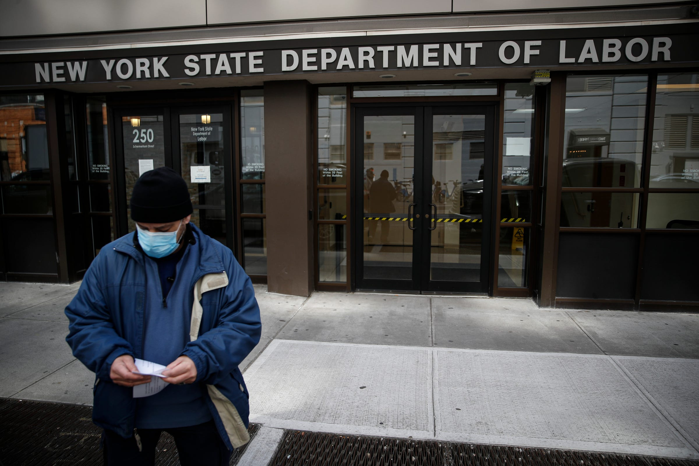 FILE - In this March 18, 2020 file photo, visitors to the Department of Labor are turned away at the door by personnel due to closures over coronavirus concerns. The coronavirus pandemic has already hurt many households financially. Americans have been hit with layoffs, furloughs and reduced hours across the country. Those who have not are still facing massive economic uncertainty. Experts say it's more important than ever to manage your budget, reach out to lenders and seek protections available to those hit by the economic impact of the virus. (AP Photo/John Minchillo, File)