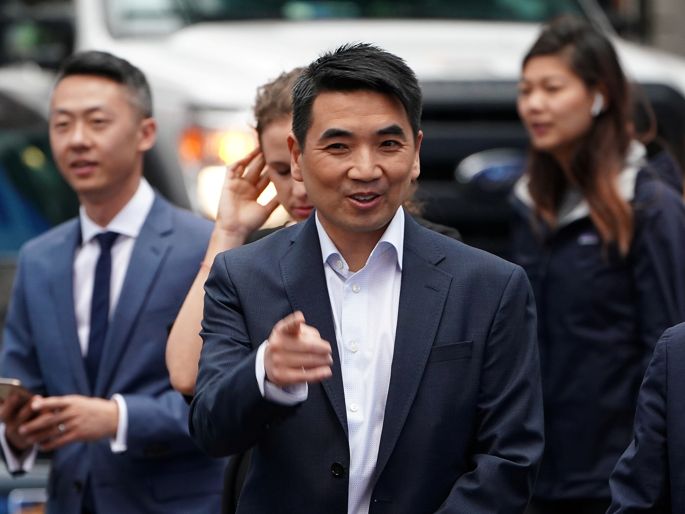 FILE PHOTO: Eric Yuan, CEO of Zoom Video Communications walks on the street as he takes part in a bell ringing ceremony at the NASDAQ MarketSite in New York, New York, U.S., April 18, 2019. REUTERS/Carlo Allegri