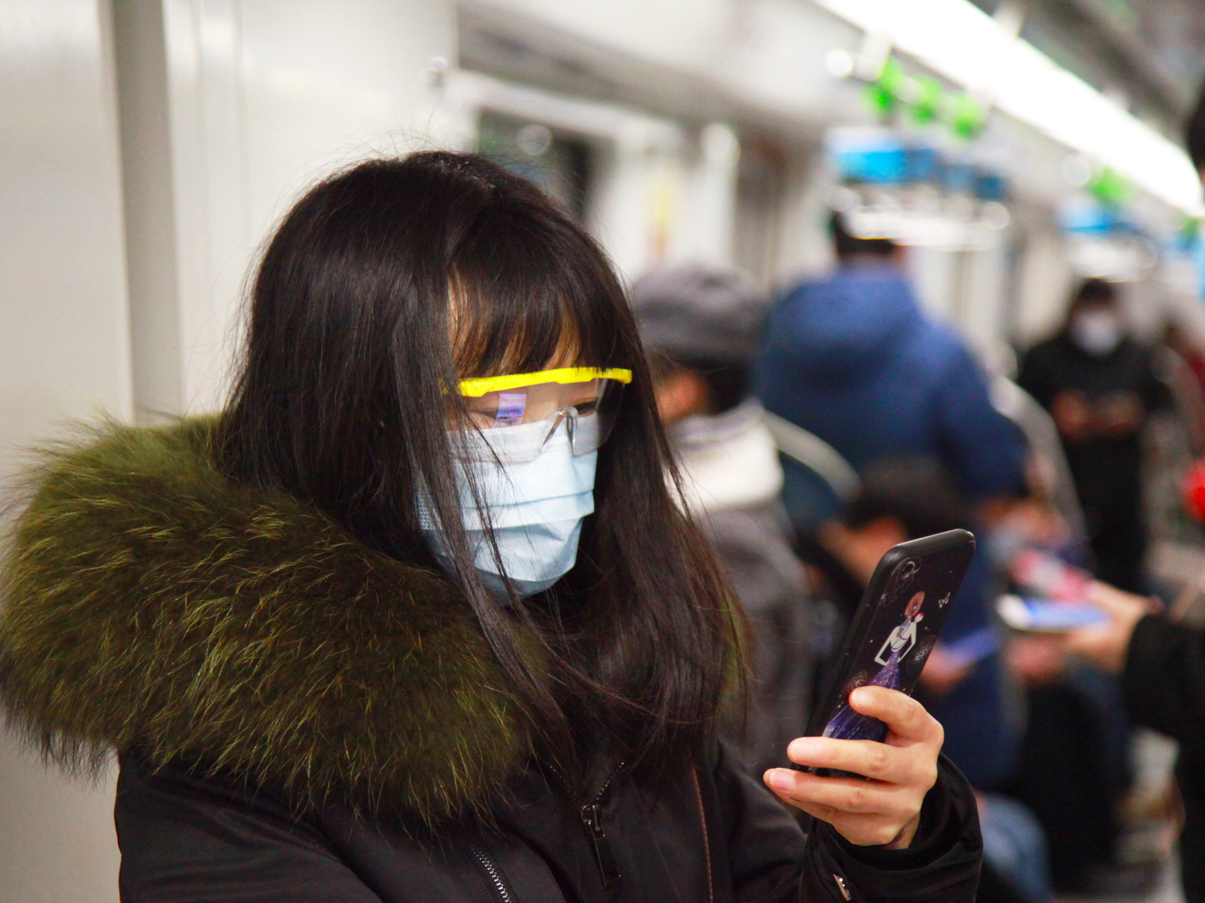 woman coronavirus phone mask train code