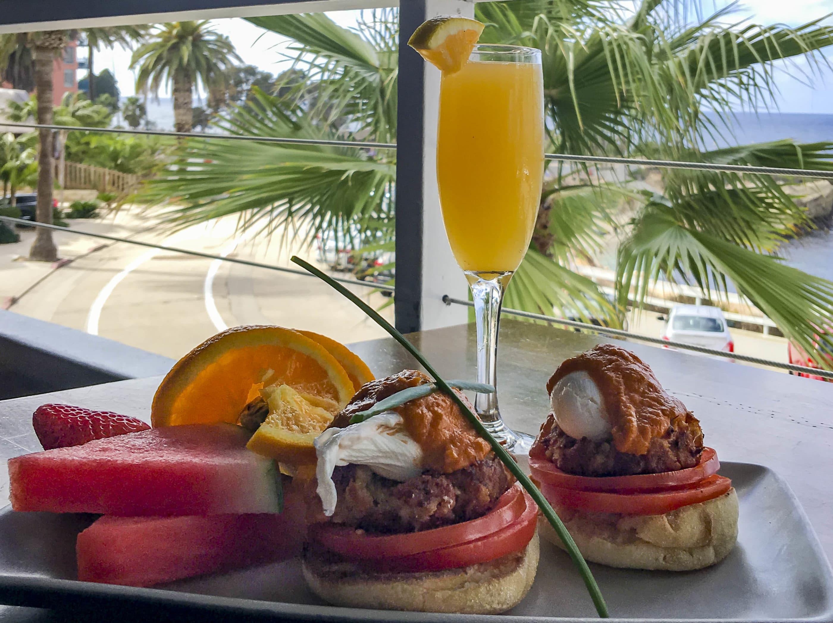 The Crab Ipanema Benedict and mimosa at Brockton Villa, a popular La Jolla breakfast restaurant.