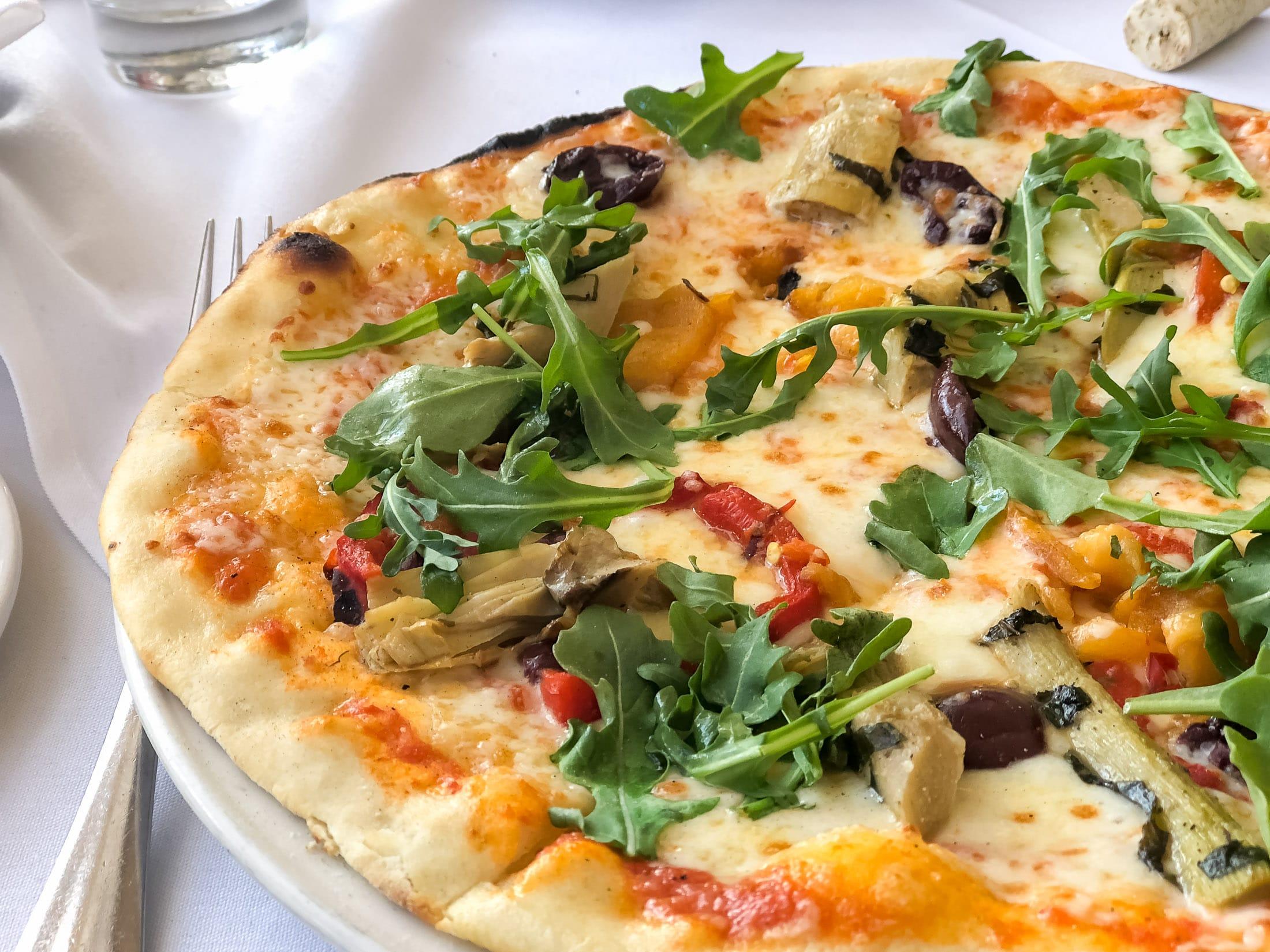 A wood-fired pizza on the table at Piatti, a popular La Jolla Italian restaurant.