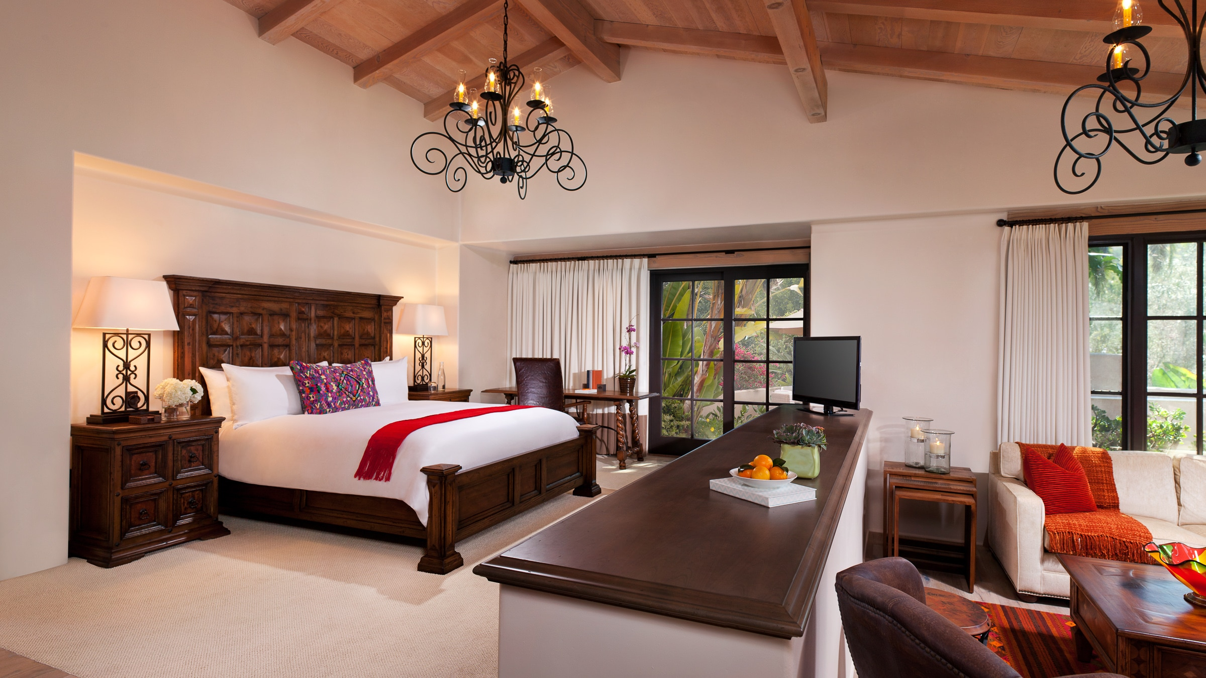 Olive Grove Suite bedroom with vaulted ceiling at Rancho Valencia, a popular San Diego family resort.
